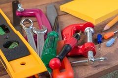 Conceitos de madeira do fundo das ferramentas de funcionamento com copyspace Foto de Stock