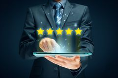 Conceitos do feedback, da revisão e da avaliação foto de stock