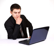 Conceived businessman with laptop Stock Photography