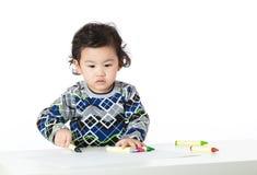 Concentrado asiático del bebé en el dibujo Imágenes de archivo libres de regalías