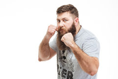 Concentraited man standing in boxer position and ready to fight Stock Photo