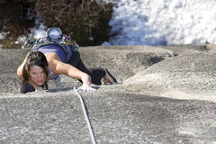 Concentrate. A fit and attractive girl climbs a granite rock in Squamish British Columbia Canada Royalty Free Stock Image