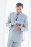 Concentrate businessman using tablet pc Stock Image