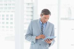 Concentrate businessman using tablet pc Stock Images