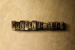 CONCENTRATE - close-up of grungy vintage typeset word on metal backdrop Stock Photo