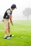 Concentrate golfer lining up his shot Stock Photo