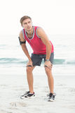 Concentrate handsome runner doing break. At the beach Royalty Free Stock Images