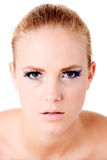 Concentrate and look deeply into my eyes. Close portrait of a blond model looking like she is hypnotizing you Stock Image