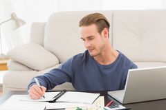 Concentrate man counting his bills Royalty Free Stock Image