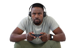 Concentrate man playing video games. Against white background Royalty Free Stock Image