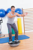 Concentrate man training in bosu ball Stock Images