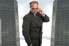 Concentrate. Mature business man thinking taking off his glasses Stock Photography