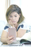 Concentrate on mobile phone. Serious face Stock Images
