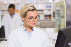 Concentrate pharmacist looking at computer. At the hospital pharmacy Stock Photos