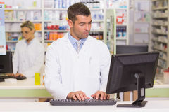 Concentrate pharmacist using computer. At the hospital pharmacy Stock Photos