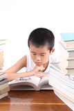 Concentrate on reading. The boy to concentrate on reading stock images