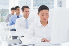 Concentrate work team using computer. In office Stock Image