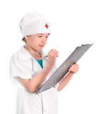 Concentrate young nurse writing medical report Royalty Free Stock Image