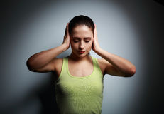 Concentrate young woman thinking and holding head with pain Stock Photography