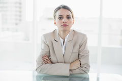 Concentrated blonde businesswoman looking at camera Royalty Free Stock Photography