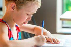 Concentrated boy draws   on paper Stock Images
