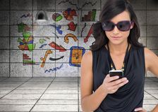 Concentrated brunette wearing sunglasses texting Stock Images