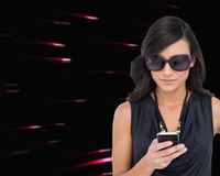 Concentrated brunette wearing sunglasses texting Stock Photos
