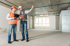 Concentrated builders keeping important documents Stock Images