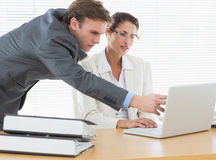 Concentrated business couple using laptop Royalty Free Stock Photo