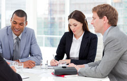 Concentrated business group having a meeting Stock Photography