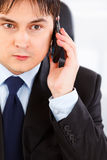 Concentrated business man talking on mobile Stock Photography