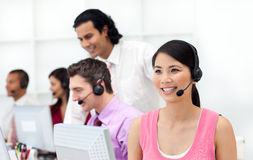 Concentrated business people with headset on. Working in a call center Stock Image