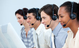 Concentrated business people using headset. In a call center Stock Photos