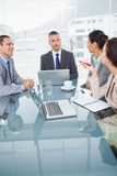 Concentrated business people working together over coffee Stock Image