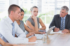 Concentrated business team during meeting Stock Photo