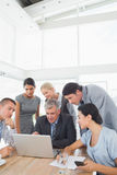 Concentrated business team working on laptop Stock Images