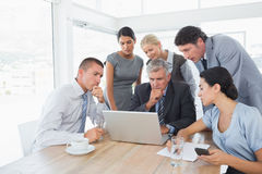 Concentrated business team working on laptop Stock Photography