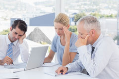 Concentrated business team working together Stock Photo