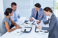 Concentrated business team working together Royalty Free Stock Images