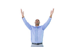A concentrated businessman with arms up Royalty Free Stock Image