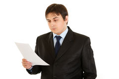 Concentrated businessman checking document Royalty Free Stock Images