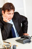 Concentrated businessman expecting phone call Royalty Free Stock Image