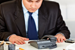 Concentrated businessman expecting phone call Stock Images