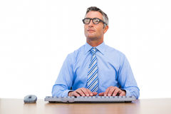 Concentrated businessman with glasses typing on keyboard Stock Photos