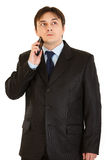 Concentrated businessman holding mobile at head Royalty Free Stock Photography