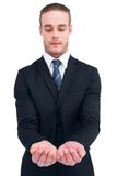 Concentrated businessman holding out his hands Royalty Free Stock Image