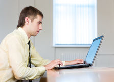 Concentrated businessman with laptop royalty free stock image