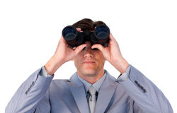Concentrated businessman looking through binocular Stock Photos