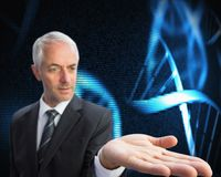 Concentrated businessman with palm up presenting holographic dna spiral Royalty Free Stock Images