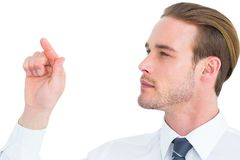 Concentrated businessman pointing with his finger Royalty Free Stock Photography